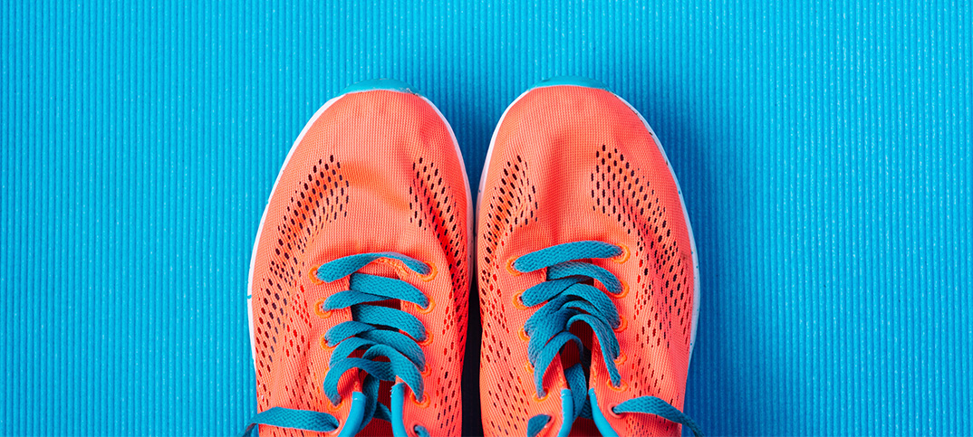 Bright colored fitness sneakers on a blue background