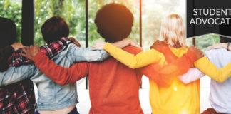 Student advocate: Back of a group of students with arms around each other