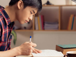 Asian boy studying at desk