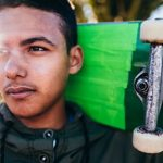 Student Advocate - ambitious male with skateboard