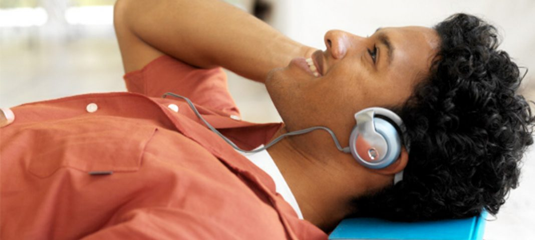 Man laying on the floor with headphones on