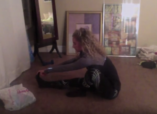 Student performing stretches