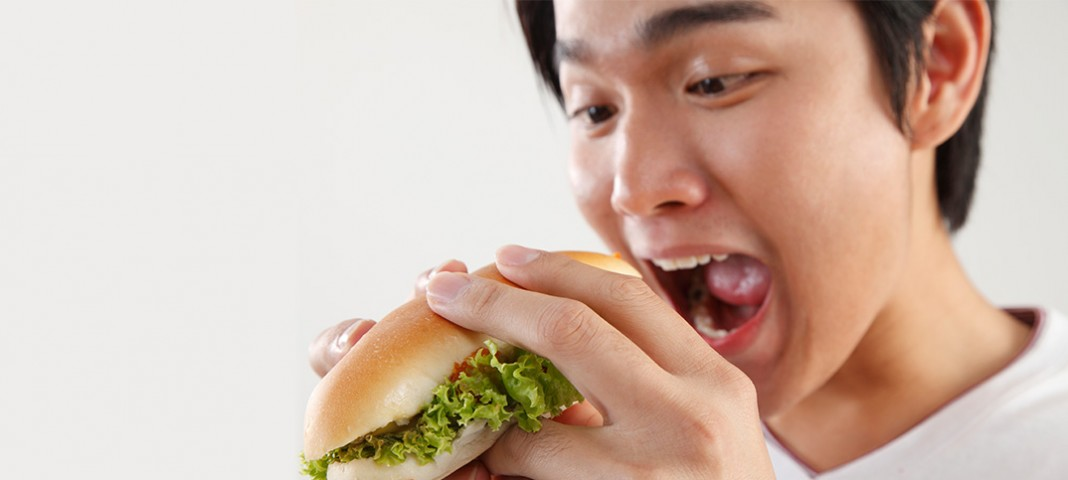 Young male eating sandwich