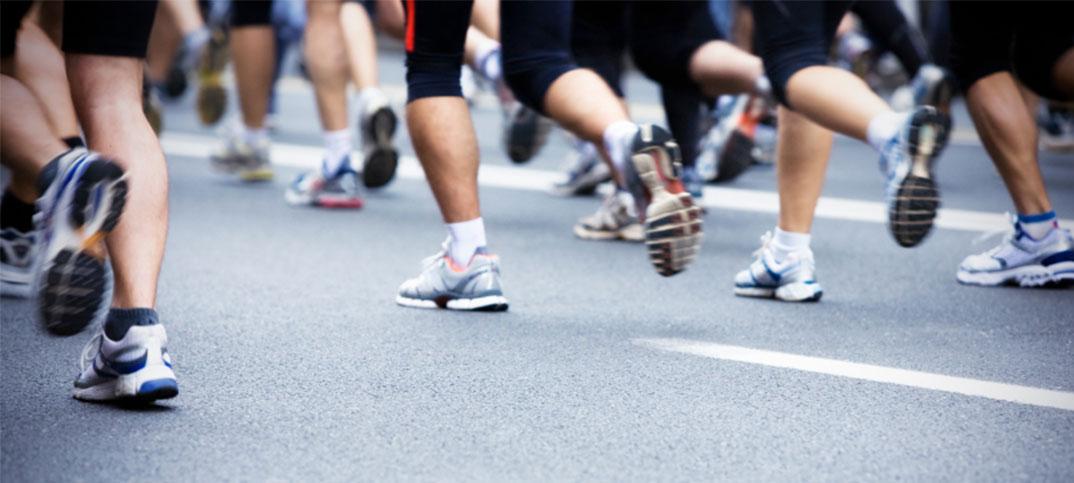 Group of people running a marathon
