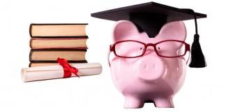 Piggy bank wearing graduation cap, books, and diploma