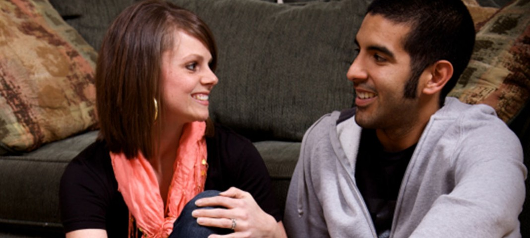 Two people smiling and talking