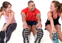 Three people stretching