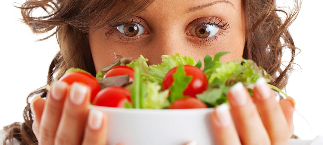 Woman holding salad