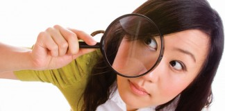 Female with magnifying glass
