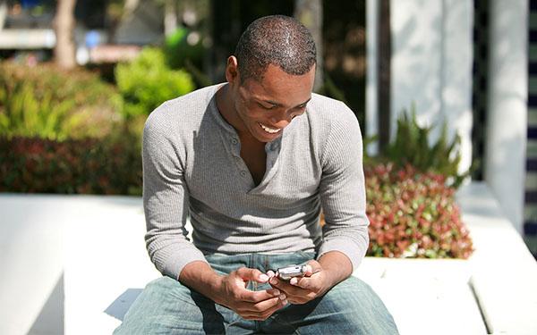 man looking at his phone