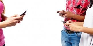 Three people on their smart phones