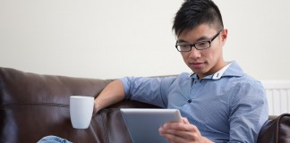 Male student using tablet