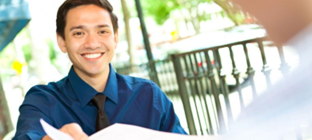 Man handing his resume to someone