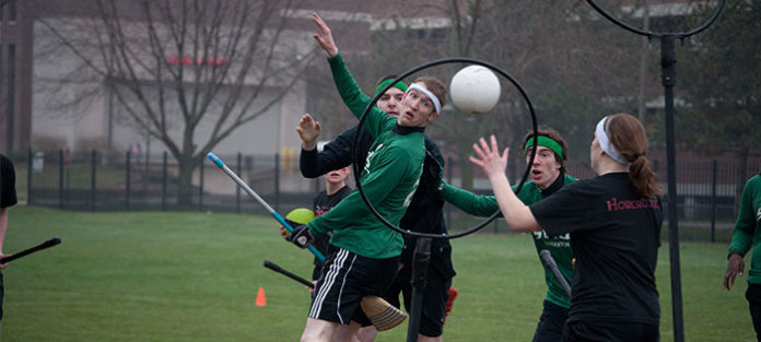 Group of college students playing quidditch