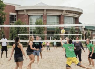 Group of students playing volleyball