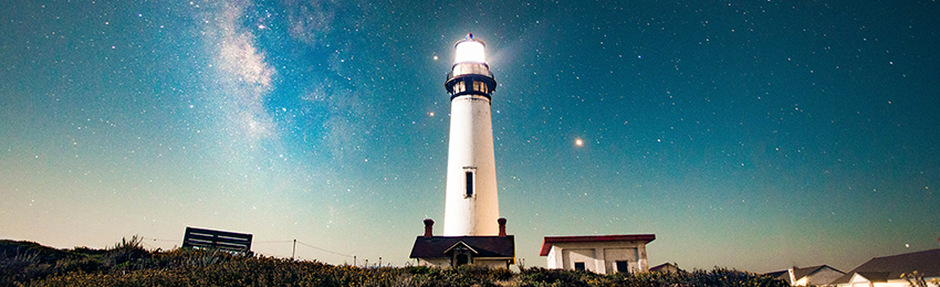 Picture of a lighthouse against a starry sky