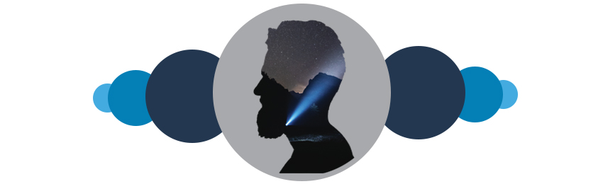 Image of a man's head in silhouette with a starry night and flashlight inset