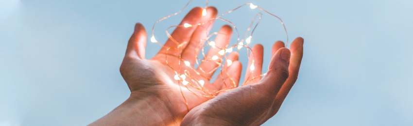 Image of a person's hands holding lights