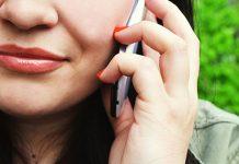 Women calling someone using a smartphone