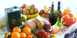 Example of foods incorporated into a Mediterranean Diet (fruits, whole grain bread, olive oil, wine)