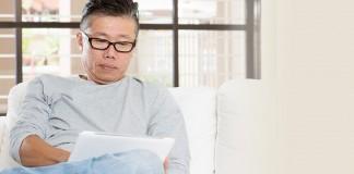 Older male using tablet