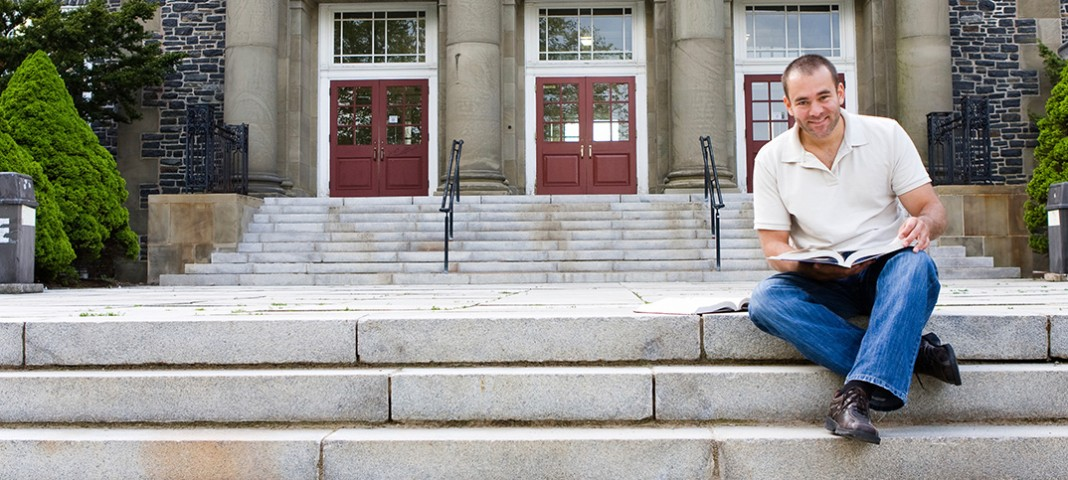 man studying on steps