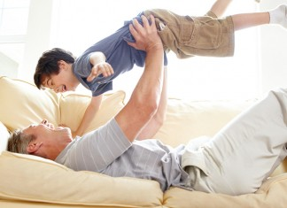 man playing with son