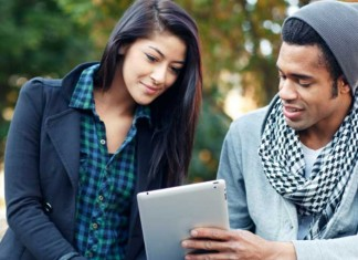 Man and woman sharing tablet