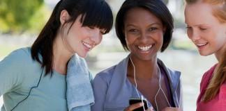 Three girls looking at a phone