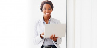 Woman holding laptop smiling