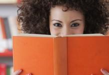 Girl holding orange book
