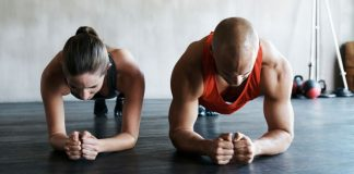 Man and woman exercising in gym space