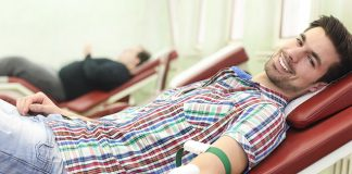 Male-college-student-getting-his-blood-taken
