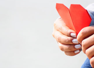 person holding a red piece of paper