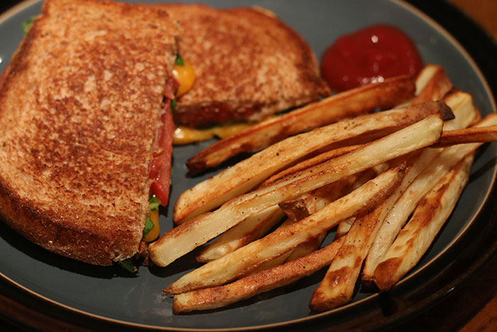 Finished plate with grilled cheese and french fries