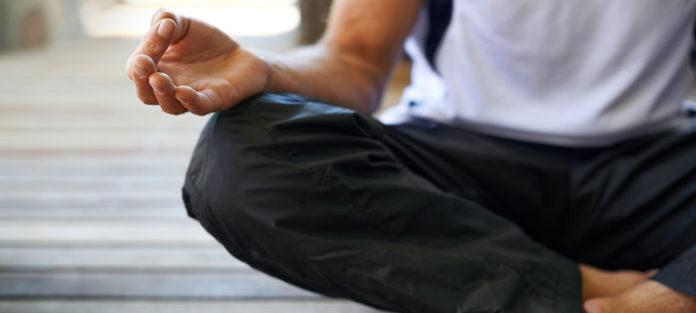 Close up of guy meditating