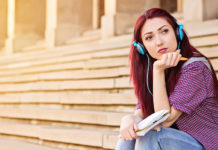 Female student sitting on staircase