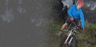 Man biking in rainy weather