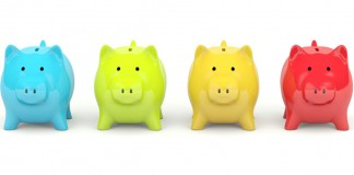 Four different colored piggy banks