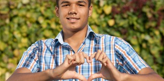 Man making heart symbol with hands