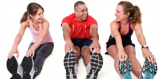 Three people stretching