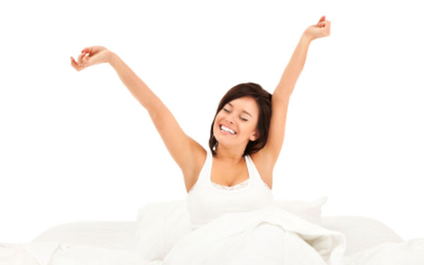 woman stretching after sleep