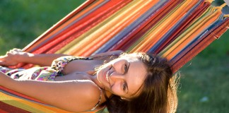 happy woman in hammock