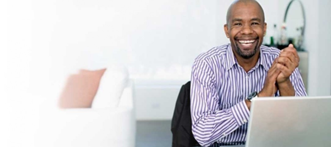 Smiling man at computer