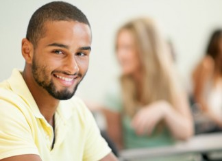 Man smiling sitting in class