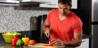 man cutting up veggies