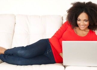 Woman checking credit on computer
