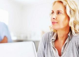 Pensive woman using laptop
