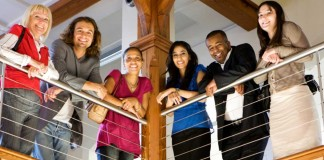 Group of diverse people standing on balcony