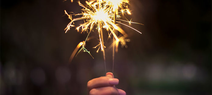 Person-holding-up-a-sparkler